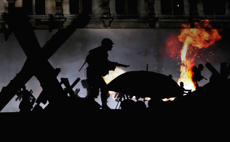 A light show is staged during a celebration marking the 70th anniversary of Paris Liberation from Nazi rule, in Paris, France, Aug. 25, 2014. French President ...