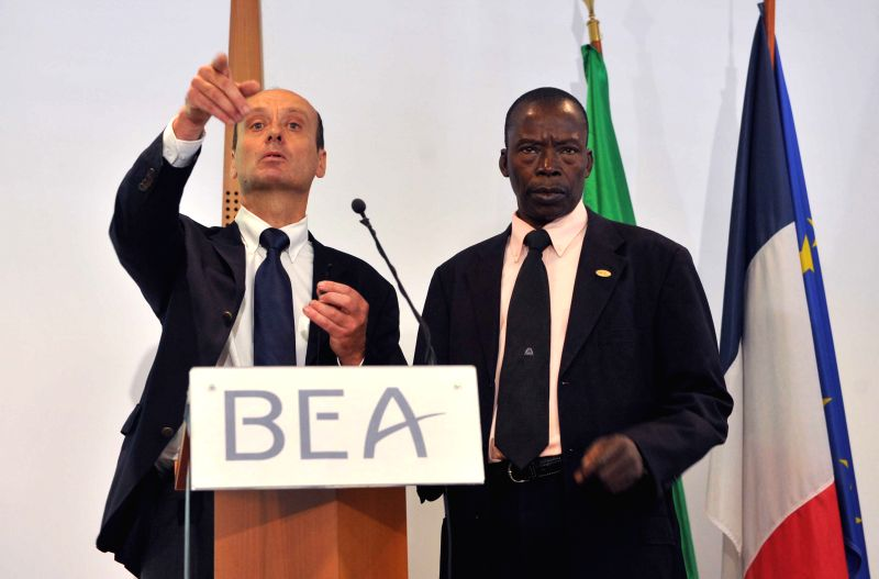 Remi Jouty (L), president of France's Bureau of Investigation and Analysis for Civil Aviation Safety (BEA) air accident investigator, and Malian Civil Aviation ...