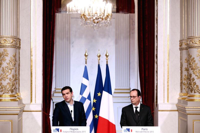 French President Francois Hollande(R) and Greek Prime Minister Alexis Tsipras attend the joint press meeting at the Elysee Palace in Paris, France, Feb. 4, 2015. ... - Alexis Tsipras