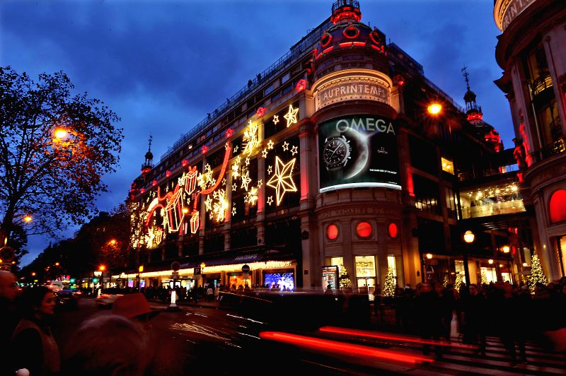 Paris (France): Christmas lights decorate the facades of a shopping mall in Paris, France, on Nov. 27, 2014.