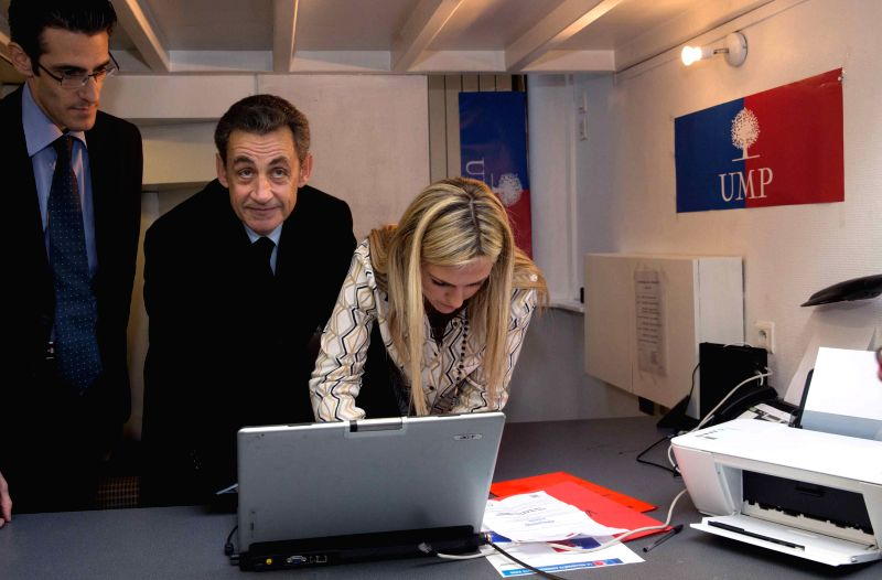 Paris (France): Former French President Nicolas Sarkozy (C) casts his ballot in Paris, France, on Nov. 29, 2014. Former French president Nicolas Sarkozy on Saturday won the race to the leadership of .