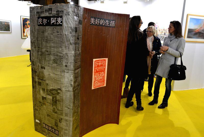 """Paris (France): People visit the 2014 """"Art en Capital"""" at the Grand Palais in Paris, France, Nov. 25, 2014. The 6-day exhibition kicked off here on Tuesday."""