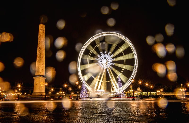 Paris (France): Photo taken on Nov. 25, 2014 shows the ferris wheel and Christmas lights in Paris, France.