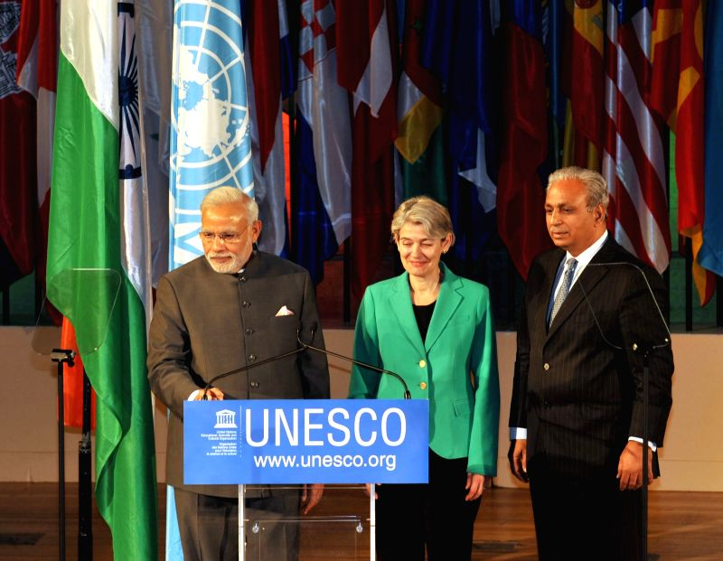 Paris (France): Prime Minister Narendra Modi launches a website on Yoga, at UNESCO, in Paris on April 10, 2015. Also seen the Director-General of UNESCO Irina Bokova. - Narendra Modi