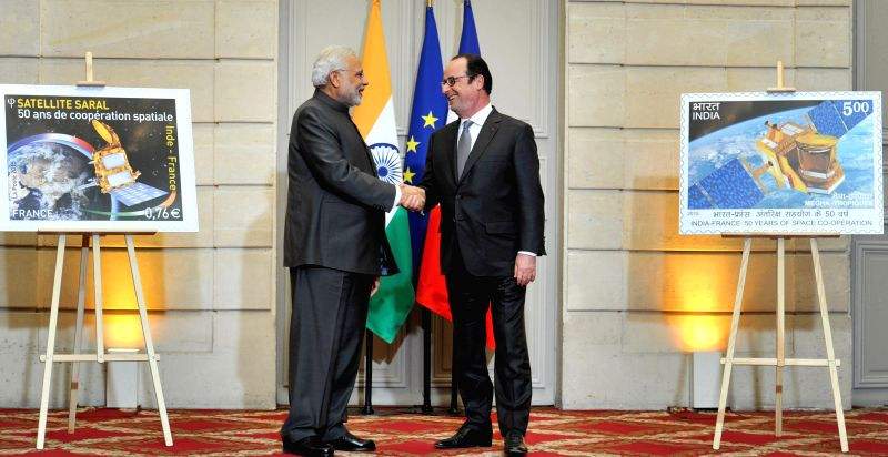 Paris (France): Prime Minister Narendra Modi and the French President Francois Hollande at the release of the stamp commemorating 50 years of Indo-French Space Cooperation, France on April 10, 2015. - Narendra Modi