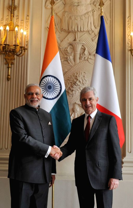 Paris (France): Prime Minister Narendra Modi with the President of the French National Assembly Claude Bartolone, in Paris on April 10, 2015. - Narendra Modi