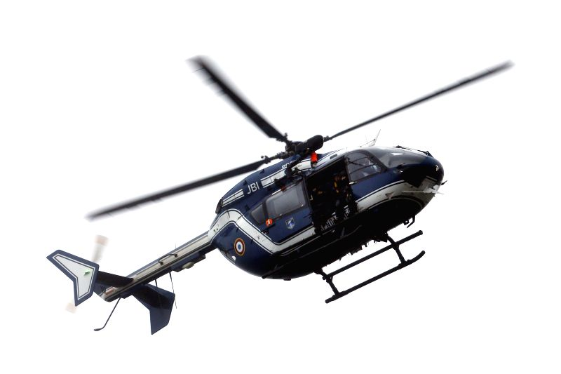 "A helicopter flies over the street of Damartin-en-Goele, France, Jan. 9, 2015. French Interior Minister Bernard Cazeneuve said Friday morning ""an important ... - Bernard Cazeneuve"