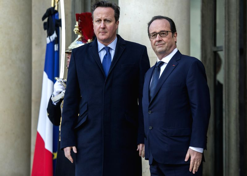 French President Francois Hollande (R) welcomes British Prime Minister David Cameron at the Elysee Palace in Paris, France, Jan. 11, 2014. A massive march commenced .. - David Cameron