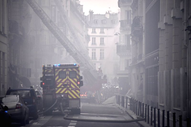 PARIS, Jan. 12, 2019 - Firefighters work at a blast site amid smoke and dust in Paris, France, Jan. 12, 2019. A huge gas explosion in central Paris injured at least 20 people on Saturday, of whom two ...
