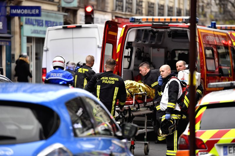 PARIS, Jan. 12, 2019 - Firefighters work at a blast site in Paris, France, Jan. 12, 2019. A huge gas explosion in central Paris injured at least 20 people on Saturday, of whom two were in critical ...