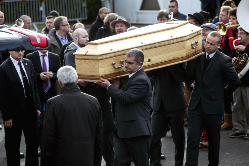 Family and guests escort the coffin of 'Charb' (Stephane Charbonnier) after his Funeral Service in Pontoise near Paris, France, 16 January 2015.