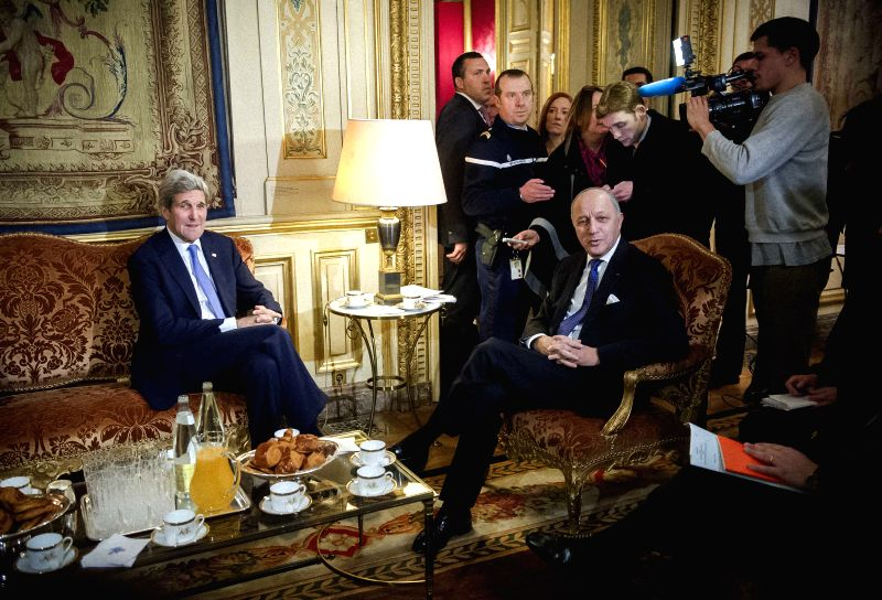 French Foreign Affairs minister Laurent Fabius (R) meets with visiting US Secretary of State John Kerry at the prime minister's office in Paris, France, Jan. 16, ... - Laurent Fabius