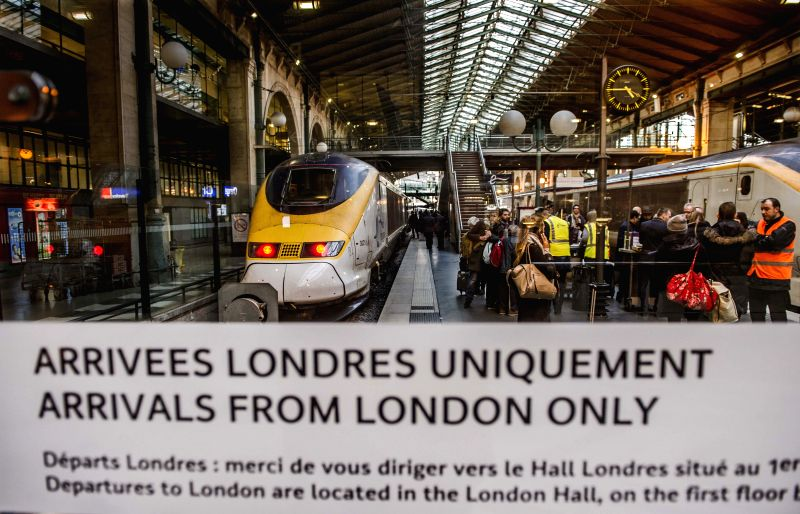 Passengers get off a Eurostar train that reversed from the Channel Tunnel due to a fire alarm at the Gare du Nord train station in Paris, France, Jan. 17, 2015. All ..