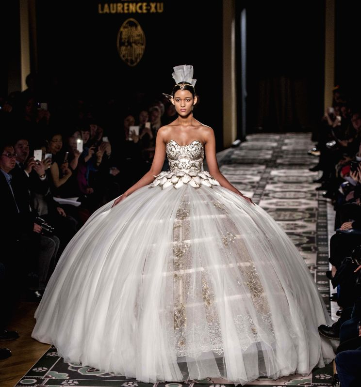 A model presents a creation by Laurence Xu of his 2015 Haute Couture Spring-Summer collection fashion show in Paris, France, Jan. 27, 2015.