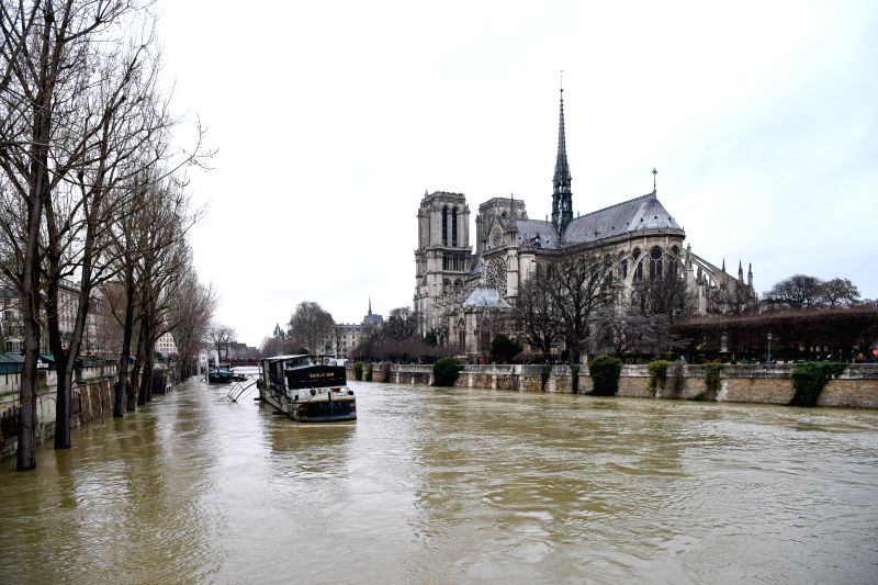 PARIS, Jan. 28, 2018 - Photo taken on Jan. 28, 2018 shows the Seine River near the Notre-Dame in Paris, France. The Seine river, which runs through Paris, kept rising on Sunday and had led to the ...