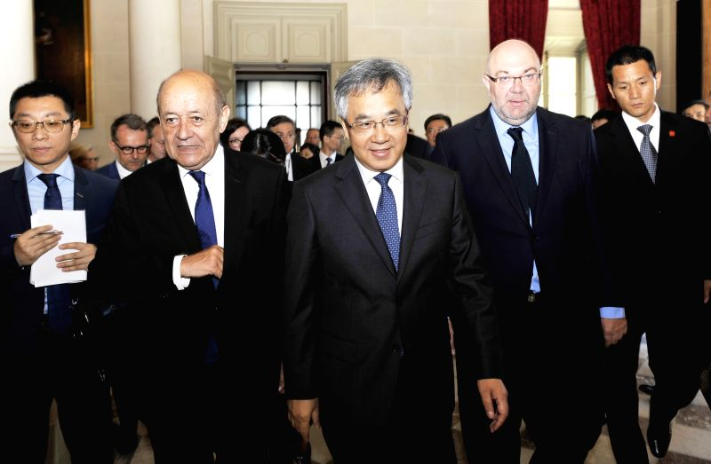 PARIS, July 11, 2018 - Visiting Chinese Vice Premier Hu Chunhua (C) meets with French Foreign Minister Jean-Yves Le Drian (2nd L) and Agriculture Minister Stephane Travert (2nd R) in Paris, France, ... - Jean-Yves L
