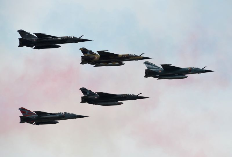 French Air Force aircrafts fly in formation over Paris during the annual Bastille Day military parade, in France, on July 14, 2014. France celebrated National Day ...