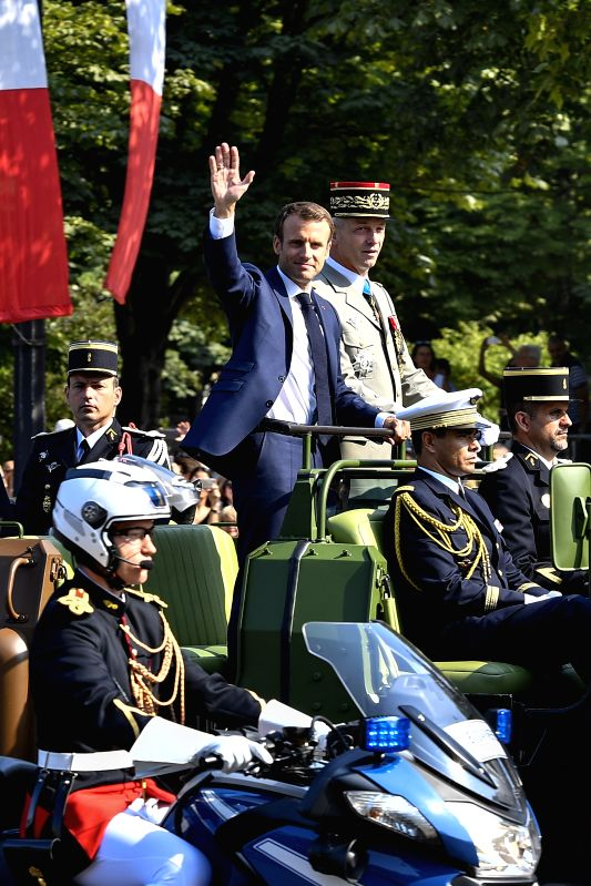 PARIS, July 14, 2018 - French President Emmanuel Macron (C) inspects the military during the annual Bastille Day military parade on the Champs-Elysees Avenue in Paris, France, on July 14, 2018.