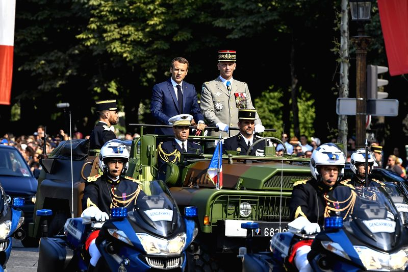 PARIS, July 14, 2018 - French President Emmanuel Macron (L) inspects the military during the annual Bastille Day military parade on the Champs-Elysees Avenue in Paris, France, on July 14, 2018.
