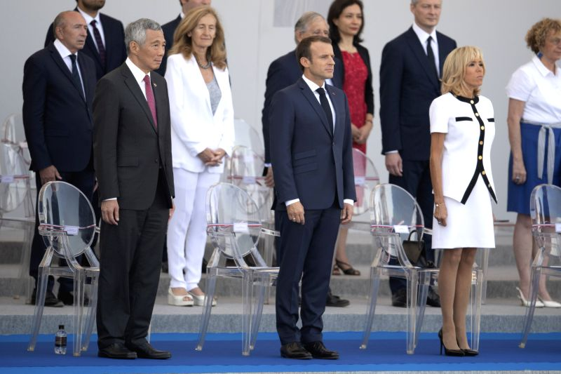PARIS, July 14, 2018 - French President Emmanuel Macron (C) and Singapore's Prime Minister Lee Hsien Loong (L) attend the annual Bastille Day military parade in Paris, France, on July 14, 2018. - Lee Hsien Loong