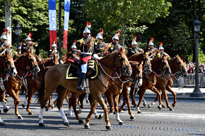 PARIS, July 14, 2018 - The Marching Band of the Cavalry Regiment of the Republican Guard Legion march during the annual Bastille Day military parade on the Champs-Elysees Avenue in Paris, France, on ...