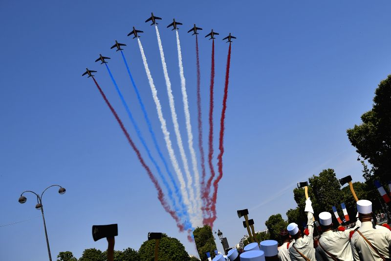 PARIS, July 14, 2018 - The Patrouille de France passes over the Champs-Elysees Avenue during the annual Bastille Day military parade in Paris, France, on July 14, 2018.