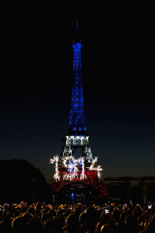 Fireworks marking the centenary of the First World War explode in front of the Eiffel Tower during the Bastille Day celebrations in Paris, capital of France, July 14,