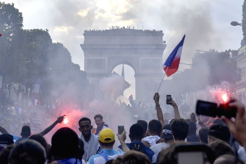 PARIS, July 16, 2018 - Fans celebrate on the Champs-Elysees Avenue for the championship of the French team in Paris, France on July 15, 2018. The French soccer team beat the Croatia team by 4-2 and ...