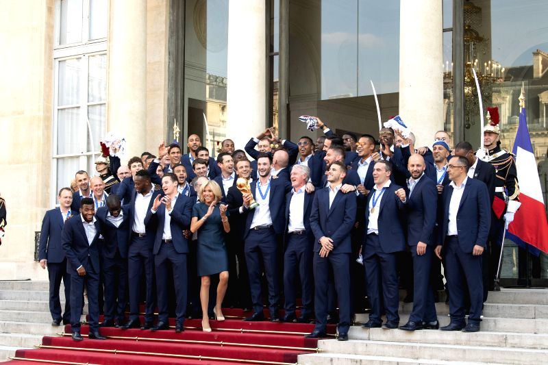PARIS, July 17, 2018 - French President Emmanuel Macron (C) poses for photos with the French football team members at the Elysee Palace in Paris, France, on July 16, 2018. The French President ...