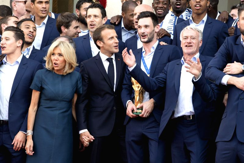 PARIS, July 17, 2018 - French President Emmanuel Macron (3rd L, front) and his wife Brigitte Macron (2nd L, front) pose for photos with the French football team members at the Elysee Palace in Paris, ...