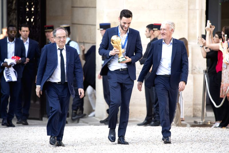 PARIS, July 17, 2018 - President of French Football Federation Noel Le Graet, Captain of the French Team Hugo Lloris and the coach of the French Team Didier Deschamps (L to R) arrive at the Elysee ...