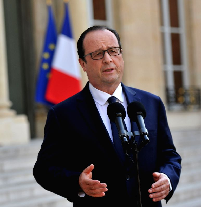 French President Francois Hollande gives a speech at the Elysee in Paris, France, July 24, 2014. The provided elements suggested that the missing Air Algerie plane ...