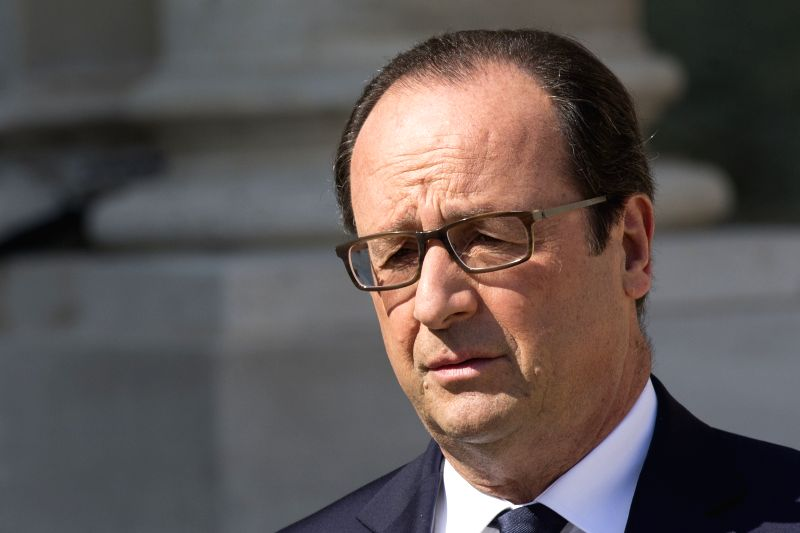 French President Francois Hollande delivers a speech regarding the situation of the crashed Air Algeria flight following an extraordinary cabinet meeting in Paris, ...