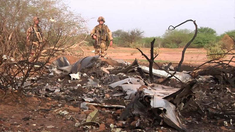 Photo released on July 25, 2014 by French Defense Ministry shows a scene of the crash site in north Mali. French President Francois Hollande and his Malian ...
