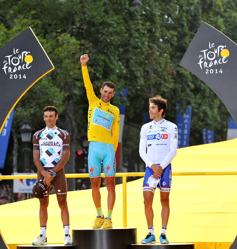 Astana team rider Vincenzo Nibali (C) of Italy, AG2R-La Mondiale team rider Jean-Christophe Peraud (L) of France and FDJ.fr team rider Thibaut Pinot of France react ..