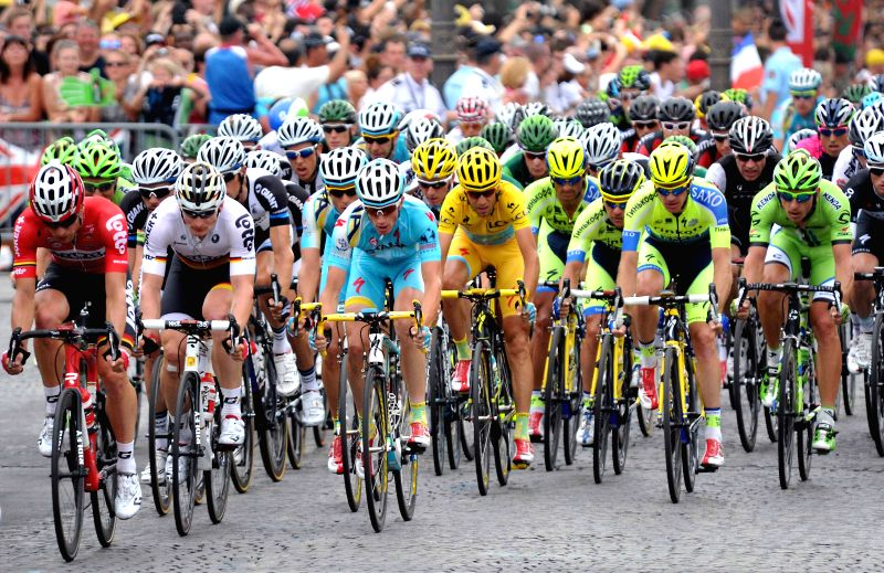 Racers compete during the 137.5 km final stage of the 2014 Tour de France in Paris, France, on July 27, 2014.