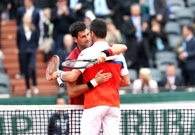 PARIS, June 1, 2016 - Novak Djokovic (L) of Serbia hugs with Roberto Bautista Agut of Spain after the men's singles fourth round match on day 11 of 2016 French Open tennis tournament at Roland ...