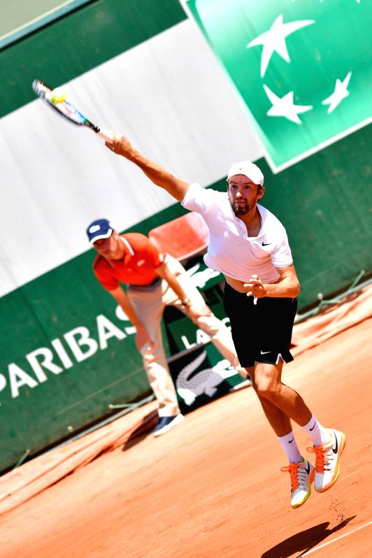PARIS, June 1, 2017 - Konstantin Kravchuk of Russia serves during the men's singles 2nd round match against Marin Cilic of Croatia at the French Open Tennis Tournament 2017 in Paris, France, on June ...