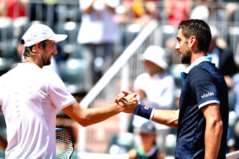 PARIS, June 1, 2017 - Marin Cilic (R) of Croatia greets Konstantin Kravchuk of Russia after the men's singles 2nd round match at the French Open Tennis Tournament 2017 in Paris, France, on June 1, ...