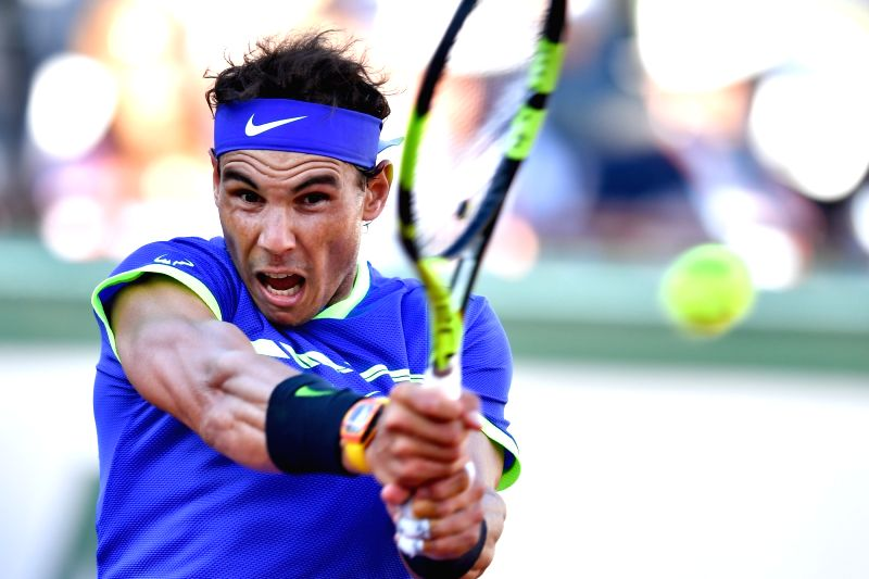 PARIS, June 10, 2017 - Rafael Nadal of Spain returns the ball during the men's singles semifinal against Dominic Thiem of Austria at the French Open Tennis Tournament 2017 in Paris, France on June 9, ...