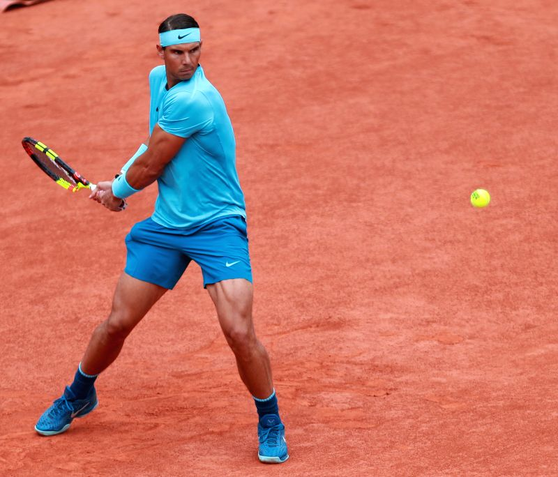 PARIS, June 10, 2018 - Rafael Nadal of Spain returns a shot during the men's singles final against Dominic Thiem of Austria at the French Open Tennis Tournament 2018 in Paris, France on June 10, 2018.
