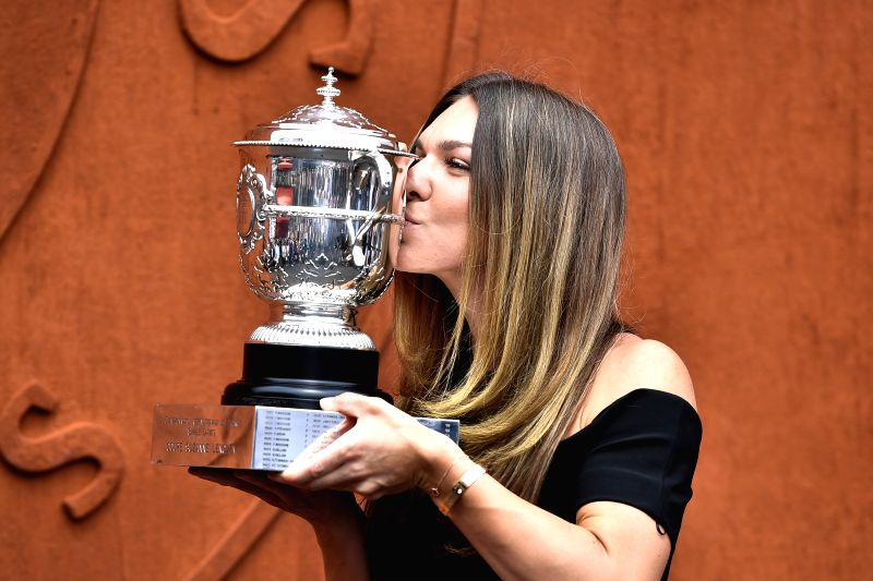 PARIS, June 10, 2018 - Simona Halep of Romania, the champion of the women's singles of 2018 French Open Tournament kisses the trophy during the photocall in Paris, France, on June 10, 2018.