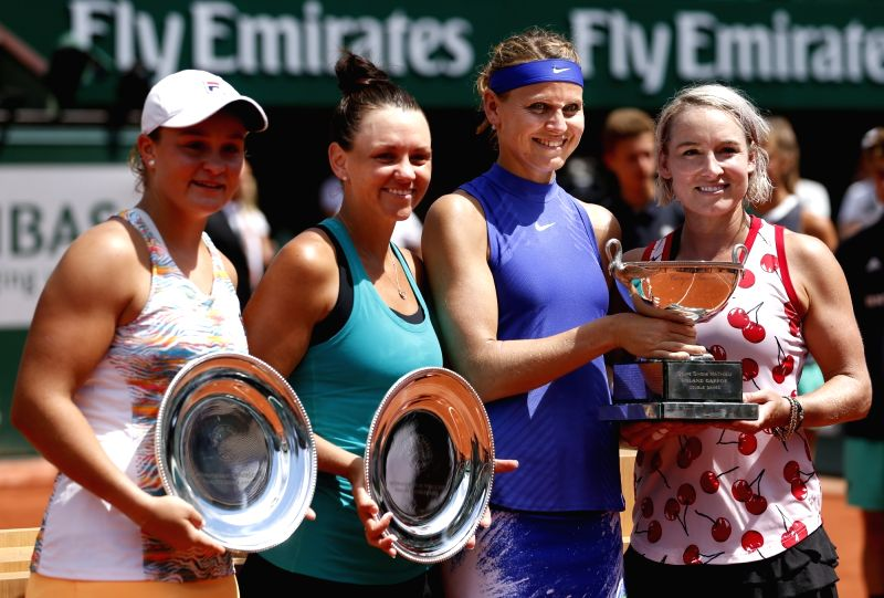 PARIS, June 11, 2017 - (L-R) Ashleigh Barty of Australia, Casey Dellacqua of Australia hold their runners-up trophies and Lucie Safarova of the Czech Republic, Bethanie Mattek-Sands of the United ...