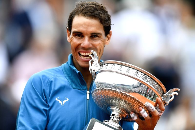 PARIS, June 11, 2018 - Rafael Nadal of Spain poses for photos during the awarding ceremony after the men's singles final against Dominic Thiem of Austria at the 2018 French Open Tournament in Paris, ...