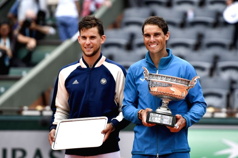 PARIS, June 11, 2018 - Rafael Nadal (R) of Spain and Dominic Thiem of Austria pose for photos during the awarding ceremony after the men's singles final at the 2018 French Open Tournament in Paris, ...