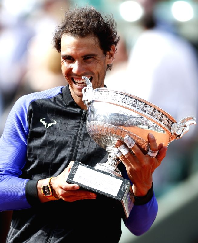 PARIS, June 12, 2017 - Rafael Nadal of Spain celebrates with his trophy after the men's singles final with Stan Wawrinka of Switzerland at French Open tennis tournament 2017 at Roland Garros, in ...