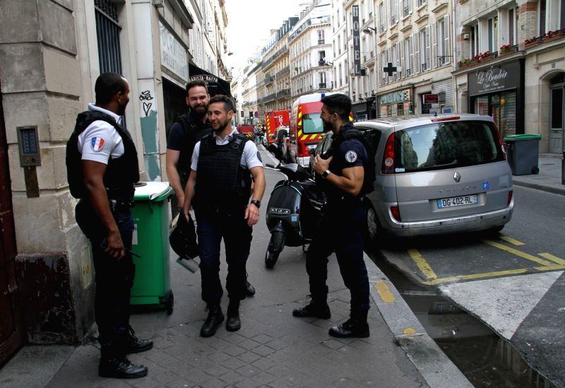 PARIS, June 12, 2018 - Police officers are seen near the site where a man held hostages in Paris, France, June 12, 2018. Police operation to dislodge an armed who seized two hostages early Tuesday at ... - Gerard Collomb