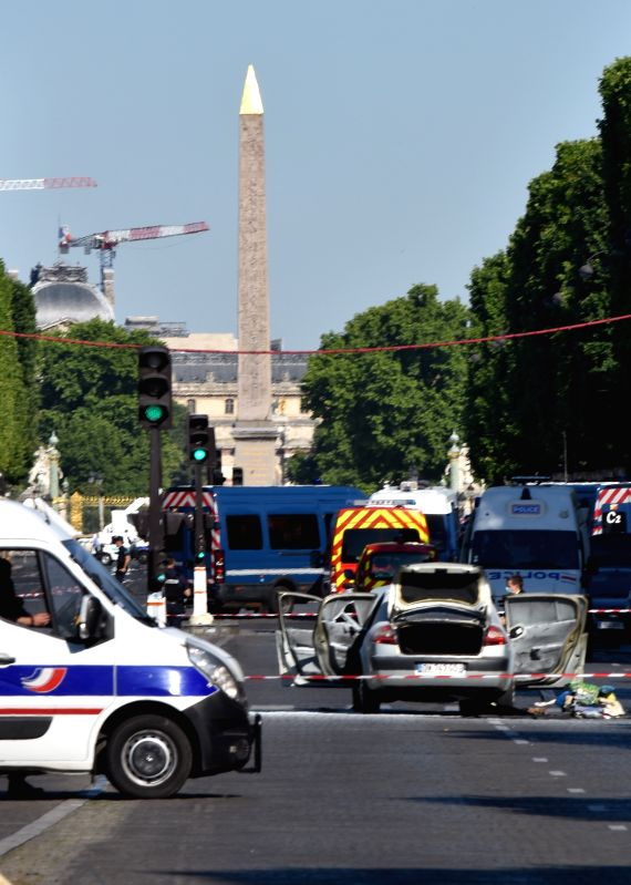 PARIS, June 19, 2017 - Photo taken on June 19, 2017 shows the site where a car rammed into a police van on the Champs-Elysees avenue in Paris, France. A car rammed into a police van Monday on the ... - Gerard Collomb