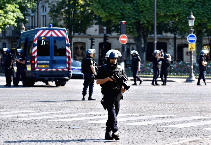 PARIS, June 19, 2017 - Police officers patrol near the Champs-Elysees avenue on June 19, 2017 in Paris, France. A car rammed into a police van Monday on the Champs-Elysees avenue in Paris before ... - Gerard Collomb