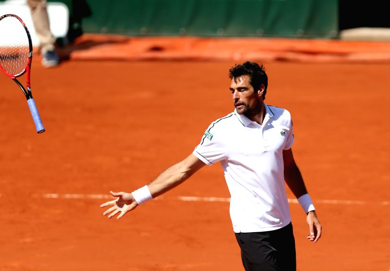 France's Jeremy Chardy reacts after making an error during the men's singles fourth round match against Britain's Andy Murray at the 2015 French Open tennis tournament ...
